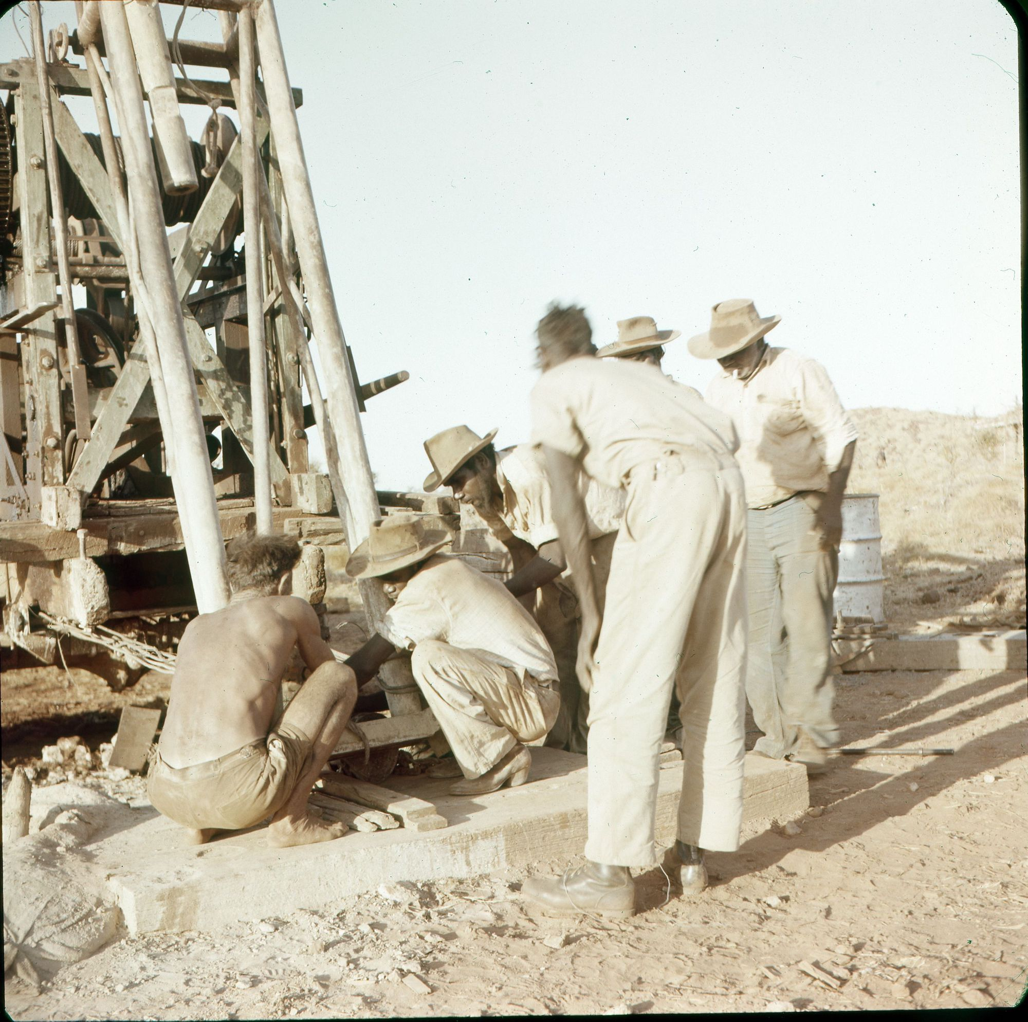Men working on a drilling plant