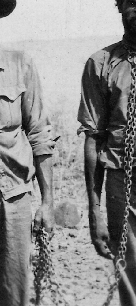 Men with Aboriginal prisoner in chains